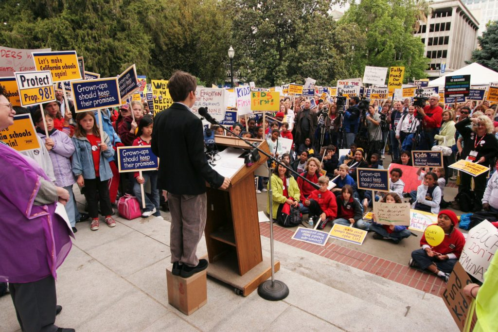 kid speaking rally